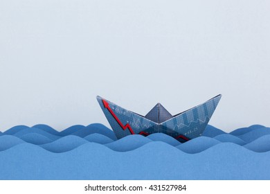Paper boat made with financial document and swimming on paper waves.