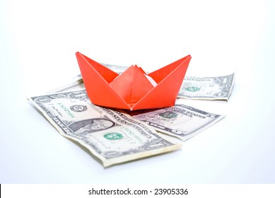 Paper boat and money