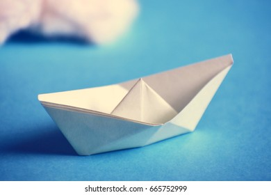 Paper Boat on Blue Background