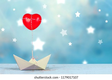 paper boat with red heart and star background