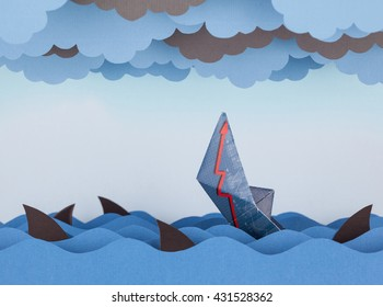Paper boat is sinking into paper sea. Paper waves, clouds and sharks. Concept of crisis and economic collapse.