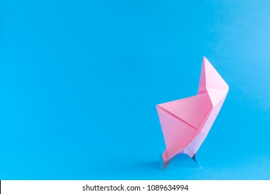 Paper boat sinking minimal creative concept.