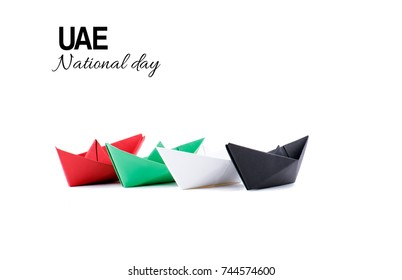 Paper boats arranged in the pattern of United Arab Emirates flag.