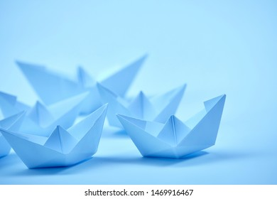 paper boats on the documents