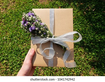 Paper box with flowers and ribbon