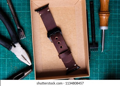 Paper box of Genuine leather watch band strap handmade crafts working with metal tool