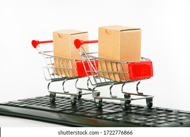 Paper box In a stainless steel trolley online business concept in white background.