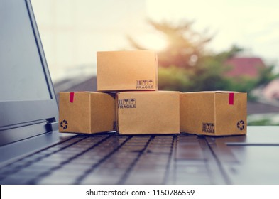 Paper boxes on a laptop keyboard.Easy shopping with finger tips for consumers.Online shopping and delivery service concept.