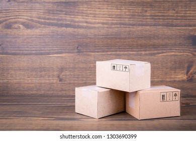 Paper boxes on wooden background. Selling goods or services online over the internet