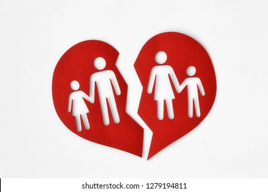 Paper broken heart with a family - Divorce and broken family concept