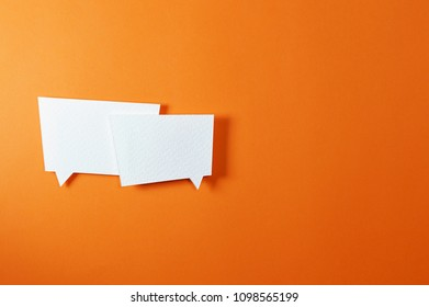 Paper bubble speech shapes on color background, ideal for your communication projects or paper topics.