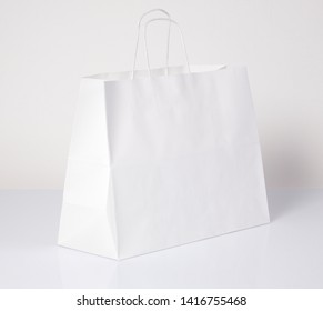 Paper Cardboard Packaging Bags Solid Color Simple Red Yellow White With Orange Flowers Standing On White Background Shopping Souvenirs Or Paper Bags