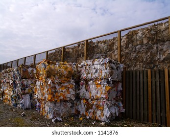 Paper and cardboard pressed in to bales for later recycling. Jutland, Denmark.