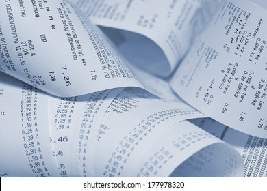 Paper cash register receipts in a lose pile close up