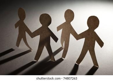 Paper Chain Men, concept of Teamwork