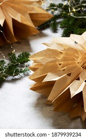 Paper Christmas stars made from craft bags.