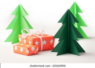 Paper Christmas trees. Winter background. Christmas card