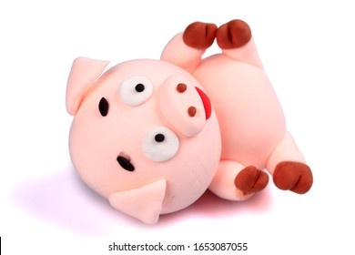 Paper clay pig on a white background