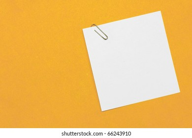 paper and paper clip on background