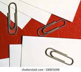 paper clips on white blank note paper isolate white