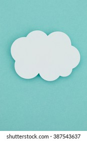 Paper cloud on a blue background.
