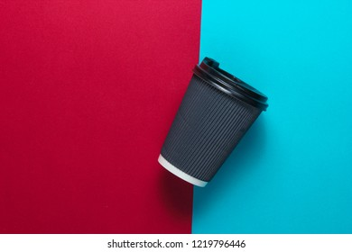 Paper coffee cup on blue red background