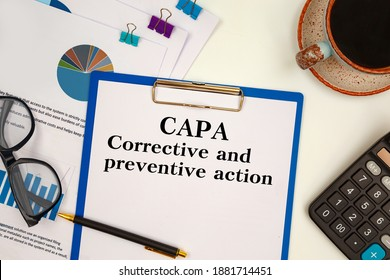 Paper with Corrective and Preventive action CAPA on the table, calculator and glasses
