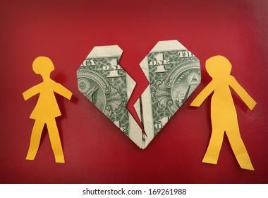 paper couple on broken dollar heart