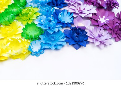 Paper craft flower rainbow color. Tolerance of people. Children's crafts creativity. White background.
