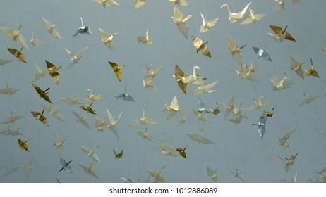 Paper cranes hanging in the air