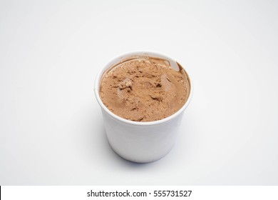 Paper cup with chocolate ice cream, just out of the freezer. A little stir, top view