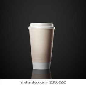Paper cup of coffee isolated on black background