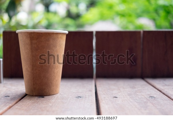 Paper cup on wood