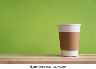 Paper cup with Sleeve on green background