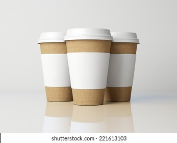 Paper cups on grey background.