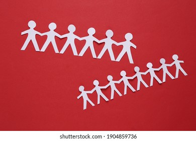 Paper cut chain of people on red background