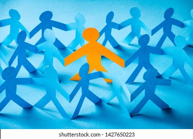 Paper cut concept - being part of the group. One different person in the group with others.