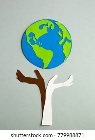 Paper cut design. Based up human's hands holding the planet Earth.