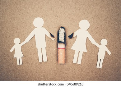 paper cut of family destroyed by cigarettes / drugs destroying family concept