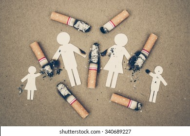 paper cut of family destroyed by cigarettes / drugs destroying family concept / world no tobacco day