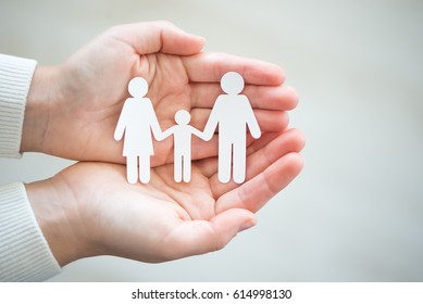 Paper cut family in two hands