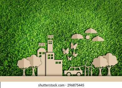 Paper cut of Green city concept on green grass