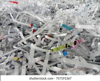 Paper cut into a shredder.