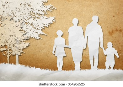 Paper cut out of a family walking in the park.