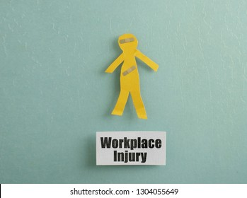 Paper cutout person with bandages and Workplace Injury message