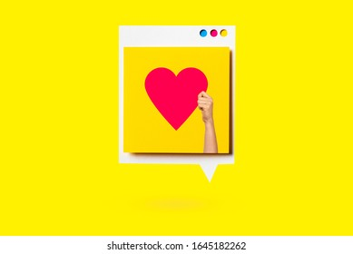 Paper cutout of red heart symbol on a white speech bubble on yellow background. Concept of social media and digital marketing.