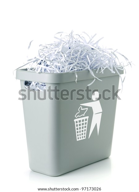 Paper cuttings in gray plastic disposal bin with white paper trash symbol - over white background
