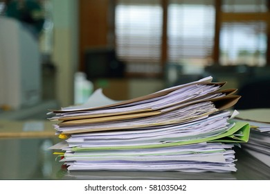 Paper documents stacked in archive.