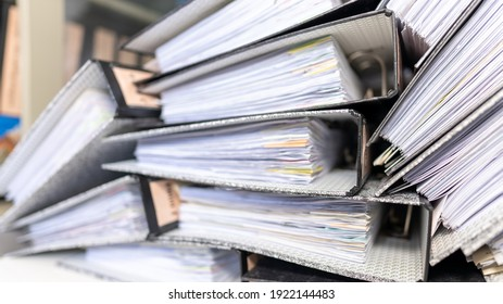 Paper documents stacked in archive at office