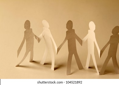 Paper doll cutouts holding hands